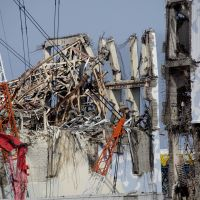 Holding the line: Wrecked reactor buildings 3 (left) and 4 are seen at Tokyo Electric Power Co.'s Fukushima No. 1 nuclear power station in the town of Okuma, Fukushima Prefecture, on Feb. 28. | POOL
