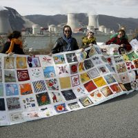 Common bond: Antinuclear activists demonstrate outside the Cruas nuclear power plant in La Coucourde, southern France, Sunday to mark the Fukushima nuclear disaster's first anniversary. | AP