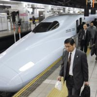 Business class: Travelers get off a shinkansen at JR Hakata Station in Fukuoka Prefecture on Monday. | KYODO