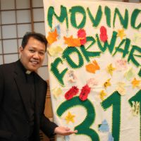 In remembrance: Filipino priest Resty Ogsimer hosts an event marking the first anniversary of the March 2011 earthquake and tsunami at the Franciscan Chapel Center in Tokyo's Roppongi district on Saturday. Below: Filipino women from Fukushima Prefecture sing during the event. | KYODO