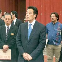 Looking to bond: Deputy Prime Minister Katsuya Okada visits Shuri Castle in Naha, Okinawa Prefecture, on Saturday before attending a symposium on tax and social reforms. | KYODO