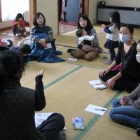 Relocation: Mothers concerned about the effects of radiation on their young children gather in a community center in Kamakura, Kanagawa Prefecture, on Feb. 15 to listen to Mamiko Joosten as she shares her experience of staying in Okinawa with her 6-year-old daughter for a month and a half prior to moving there for good this month. | KYODO