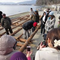 Build it and they will come: Students from Harvard Kennedy School build a raft for use in oyster farming at an oyster business in Rikuzentakata, Iwate Prefecture, on March 14. | REO WATANABE