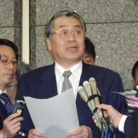 Clear the decks: Defense Minister Naoki Tanaka faces reporters Tuesday after issuing an order for the Self-Defense Forces to prepare for intercepting a North Korean rocket. | KYODO