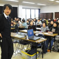 Kimura delivers a lecture on radiation to a women's group in Nihonmatsu, Fukushima Prefecture, in February. | KYODO