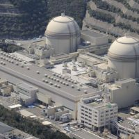 Waiting for the green light: Reactors 3 (right) and 4 at the Oi nuclear plant in Fukui Prefecture operated by Kansai Electric Power Co. are seen from the air March 27. | KYODO