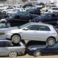 Abandoned: Cars wrecked by last year's tsunami are piled up at a yard in Ishinomaki, Miyagi Prefecture, on Tuesday. | KYODO