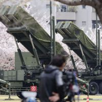 Stand down: Patriot Advanced Capability-3 interceptor missiles guard the Defense Ministry in Tokyo on Friday morning. | KYODO