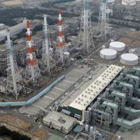 Ever more costly: The Sakaiminato power station run by Kansai Electric Power Co. in Tottori Prefecture is fired by liquefied natural gas, a commodity Japan has been snatching up to offset the loss of atomic power. | KYODO