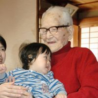 Blessed: Jiroemon Kimura, the world's oldest man and the oldest person in Japan, celebrates his 115th birthday Thursday with his great-great grandson Akikazu Oda at his home in Kyotango in northern Kyoto.? | KYODO