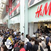 Fast fashion, long line: Customers line up to enter Swedish clothing chain H&M Hennes & Mauritz AB's new outlet in Naka Ward, Nagoya, on Saturday. | KYODO