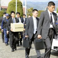 Evidence gathering: Yamaguchi police on Monday enter the Mitsui Chemicals Inc. plant in Waki the day after explosions there killed one worker and injured 22. | KYODO