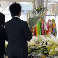 Not forgotten: Visitors to the seventh anniversary memorial service for the 2005 derailment of a JR West train in Amagasaki, Hyogo Prefecture, mark the deadly accident on Wednesday. | KYODO