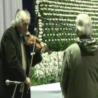 First of many: Ivry Gitlis plays a violin made of tsunami debris at a memorial service in Rikuzentakata, Iwate Prefecture, on March 11. | KYODO