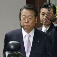 In the clear: Veteran Democratic Party of Japan lawmaker Ichiro Ozawa makes his way to the Tokyo District Court on Thursday. The former party leader was found not guilty of conspiring to falsify the financial reports of his political fund management body in 2004 and 2005. | KYODO