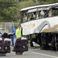 Gathering evidence: Police remove seats from a shredded bus Monday that crashed into a wall in Gunma Prefecture the previous day, leaving seven people dead and dozens injured. | KYODO