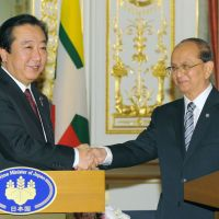 Hand in hand: Prime Minister Yoshihiko Noda (left) and visiting Myanmar President Thein Sein attend a joint news conference after a meeting in Tokyo on April 21. | KYODO