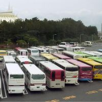 From all points: Tour buses fill a lot Monday at Tokyo Disney Resort in Urayasu, Chiba Prefecture. | KYODO
