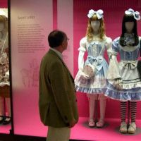 Sweetly done: Curator Rupert Faulkner checks 'Sweet Lolita' mannequins at an exhibition illustrating the fashion's British influence at London's Victoria and Albert Museum on April 23. | KYODO