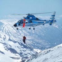Cliffhanger: A Nagano police helicopter airlifts a mountaineer who was found Saturday morning near Mount Korenge. | NAGANO PREFECTURAL POLICE / KYODO