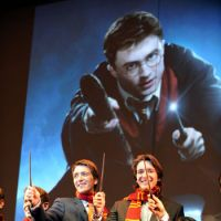 Themactrics?: Twin actors James and Oliver Phelps (center right, left) — who played Fred and George Weasley in the 'Harry Potter' movies — attend a Thursday press presentation in Osaka during which Universal Studios Japan unveiled plans to build the first international version of the theme park Wizarding World of Harry Potter. | AFP-JIJI