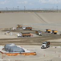 Holed up: Trucks dump toxic soil from the Hanford Site, a former U.S. nuclear complex holding millions of tons of irradiated waste, into a huge pit in Richland, Washington, on April 24. | KYODO