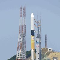 Commercial venture: An H-IIA rocket carrying South Korea's KOMPSAT-3 satellite stands on a launchpad on Tanegeshima Island off Kagoshima Prefecture on Thursday afternoon. | KYODO