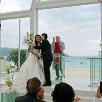 Celebration by the sea: A couple from Hong Kong hold a wedding ceremony at a resort's beach-side chapel in the village of Kunigami, Okinawa Prefecture, on April 26. | KYODO