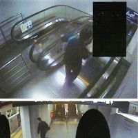 Wanted: Security video footage from Monday night shows a man suspected of stabbing another man on an escalator leading down to the Fukutoshin Line platform at Tokyo Metro Co.'s Shibuya Station. | METROPOLITAN POLICE DEPARTMENT / KYODO