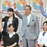 Hurdle cleared: Tokyo Gov. Shintaro Ishihara and Japanese Olympic athletes raise their fists at a news conference Thursday after it was announced that Tokyo is one of three cities still in the running to host the 2020 Summer Olympics. | AFP-JIJI