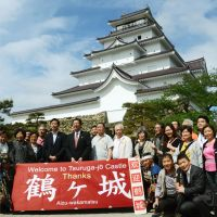 Warm welcome: Chinese tourists pose in front of Tsuruga Castle in Aizuwakamatsu, Fukushima Prefecture, on Tuesday. | KYODO