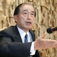 On the move: Fumio Sudo, NHK Board of Governors chairman, announces his intention to step down during a press conference in Tokyo on Thursday. He will become an outside director of Tepco. | KYODO