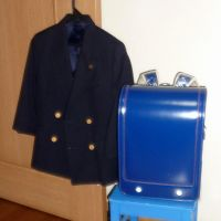 In limbo: A Shizuoka Prefecture woman's oldest son's jacket and school backpack sit unused May 5, as the boy last took them to his elementary school in April 2011. | KYODO