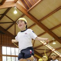 The great indoors: Children jump rope Wednesday in an indoor facility for elderly people in Koriyama, Fukushima Prefecture. The venue was opened for some 30 children from a nearby kindergarten so they can play without fear of radiation. | KYODO