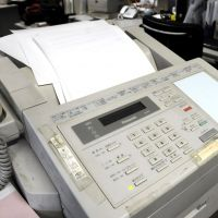 Indispensable?: An aging fax machine is still in use in an office in Minato Ward, Tokyo. | SATOKO KAWASAKI