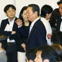 The spoiler: Democratic Party of Japan kingpin Ichiro Ozawa attends a meeting with his supporters in the lawmakers' dormitory at the Diet on Thursday. | KYODO