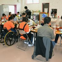 Sporadic support: People have lunch at a center for the disabled in the city of  Tamura, Fukushima Prefecture, in May. | KYODO
