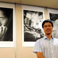 Do the right thing: Photographer Ahn Se Hong poses in front of his photographs of former sex slaves at the Foreign Correspondents' Club of Japan in Tokyo on Thursday. | SATOKO KAWASAKI