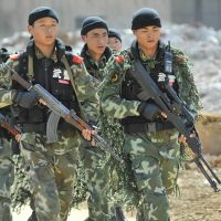 On maneuvers: Chinese troops carry out a joint military exercise code-named Miao 12 in Kaili in the southwest province of Guizhou on Monday. | AFP-JIJI