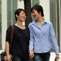Still taboo: Koyuki Higashi (right) walks with her partner, Hiroko, in  Tokyo on June 2. Despite the increasing tolerance of gay marriage in much of the developed world, the subject is not on the radar in Japan or in many parts of Asia. | AFP-JIJI