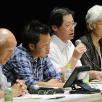 Voice of the people: A local resident expresses his opinion about nuclear power during a public hearing Wednesday in the city of Fukushima. | KYODO