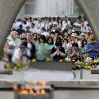 Beyond words: Prayers are offered Monday at Hiroshima Peace Memorial Park for the victims of the U.S. atomic bombing on Aug. 6, 1945.