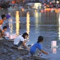 Peace envoys: Young children float paper lanterns on the Motoyasu River in front of Hiroshima's Atomic Bomb Dome on Monday, the 67th anniversary of the city's destruction during the war. | AFP-JIJI