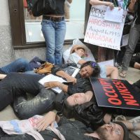 In sympathy: Protesters calling for the abolition of nuclear arms and power plants feign death in central New York on Monday. | KYODO