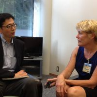 Go-to guy gone: Deputy Cabinet Secretary for Public Affairs Noriyuki Shikata (left) is interviewed by Jackie Northam of U.S. National Public Radio at the prime minister's office July 23. | AYAKO MIE