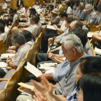 No surprise: The audience applauds during an Aug. 1 public hearing on energy policy in the city of Fukushima. Most speakers called for abolition of nuclear plants. | KYODO