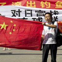 Hands off: Protesters carrying a Chinese national flag and banners reading 'Declare war against Japan' and 'Japan, get out of the Diaoyu (Senkaku Islands)' stage a demonstration outside the Japanese Embassy in Beijing on Wednesday. | AP