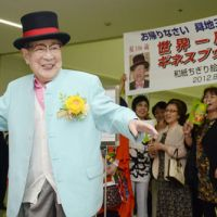 Something to declare: Saburo Shochi, professor emeritus at Fukuoka University of Education, arrives at Fukuoka airport Thursday, his 106th birthday, after a monthlong around-the-world lecture tour. | KYODO