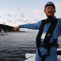 Staking a claim: Tokyo politician Eiji Kosaka gestures as a group of Japanese nationalists arrive at the Senkaku Islands on Sunday. | AFP-JIJI