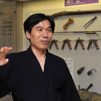 Ninja skills are demonstrated at the museum on June 30. | AFP-JIJI